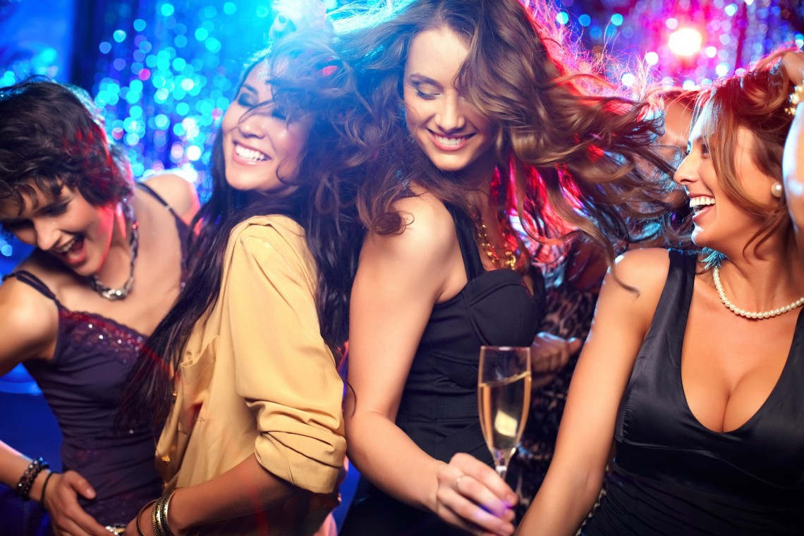 Cheerful girls living it up on the dance floor