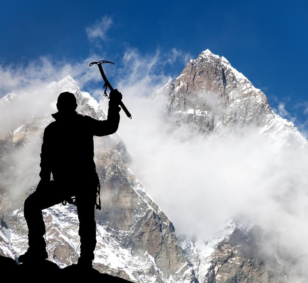Mount Lhotse and silhouette of man wirh ice axe - trek to everest base camp - Nepal